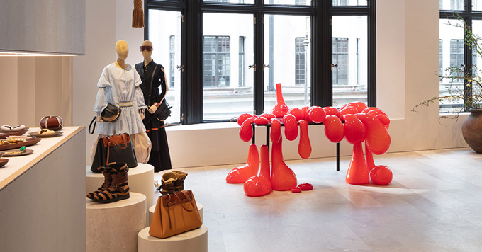 loewe flagship london store red sculpture blob shoes fashion design wooden floor window